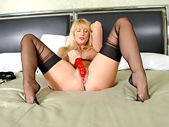 Sexy blonde housewife slips off her lingerie and fucks her dildovideo