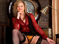 Business woman strips down to a garter and stockings to masturbatevideo