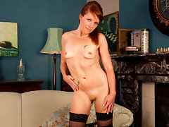 Slender Anilos redhead strips off her evening dress and masturbatesvideo