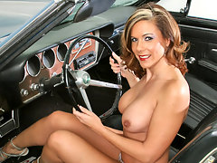 Brunette cougar with big boobs plays with her pussy in a convertiblevideo