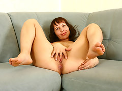 Luscious cougar milf gently strokes her Anilos pussy with a dildo inside her bedroomvideo