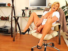 Busty blonde secretary uses a magic wand to masturbate on breakvideo