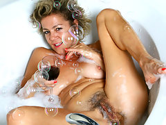 Tipsy cougar power fucks her hairy pussy in her bubble bathvideo