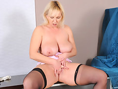 Naughty mom in glasses slips off her mini skirt and masturbatesvideo