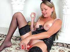 Older maid pleasures her bare pussy with assorted sex toysvideo