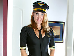 Enticing cougar takes off her pilot costume and shows her pussyvideo