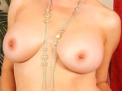 Glamorous mature blonde Anilos removes her clothing and flaunts her mesmerizing cougar framevideo