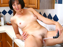 Horny milf pleases her anilos pussy any way she can as she puts her dildo, her glass wand and her fingers to good usevideo