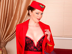 Naughty red haired flight attendant finger fucks her sweet pussyvideo
