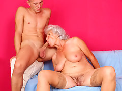 Busty grandma sucks cock and gets fucked by a young manvideo