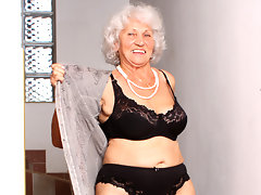 Granny with big tits stuffs her hairy pussy with a vibratorvideo