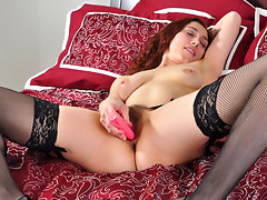 Amateur milf shakes her ass in a thong and stockings then strips them off to stuff a vibrator in her hairy bush pussyvideo