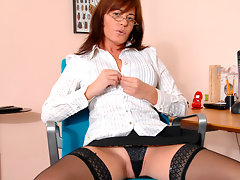 Enticing cougar secretary undresses and masturbates on breakvideo