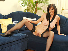 Horny cougar plays with her pussy while wearing stockings and heelsvideo