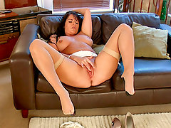 Long haired thick brunette milf in garter belt, stockings and high heels rubs her ample breasts and shaved pussyvideo