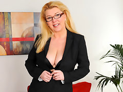 Curvy office exec undresses and fingers her shaved twatvideo