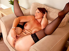 Stunning red headed milf Foxy fingers her slick pussyvideo
