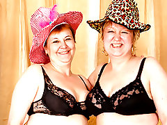 Aww, have you ever seen a couple of grannies this hot? Mature lesbians, Amalie and Agata even have little fancy old people hats on! They slowly grace their hands up and down their soft, inviting figures, Amalie making the first move and groping Agata's pussy. Then, the tits pop out, and Amalie twists Agata's nipples until she squeals! After some foreplay, Agata stuffs a string of erotic beads up Amalie's fat pussy lips!video