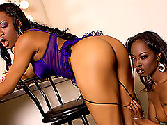 These two hot body ebony lesbian bitches don\\\'t even make it out of the dressing room!  At first we see the pretty black babes, Imani Rose and Dariel Dukes, getting ready for their shoot in the dressing room.  Both tarts are wearing some extremely stunning and slutty outfits that make them look like real street whores!  The girls obviously find each other extremely attractive as well, pausing in putting on their makeup to tongue each others bald black pussies!  The girls end up lying down on the sofa in the corner of the room, getting partially undressed once again for some explicit, hardcore lesbian pussy licking and dildo fucking action.video