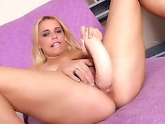 Ana Beatriz is a horny blonde with nice ample tits and hairy snatch. This hot solo masturbation scene starts with Ana kneading her tits and examining her pink pussy lips with a dildo. Ana spreads her thighs and rams her toy deep into her hair covered muff.video