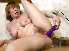 Strea is busy at work when she starts to rub her hairy legs up to her hairy mound. Her pussy hairs are poking out of her panties when she starts to finger herself right at her desk.video