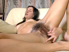 Eliza is so hairy you can see her hairy mound through her bright orange tights as she exercise. By the time she takes them off it is so wet you can almost taste it in this hairy porn.video