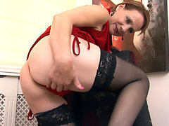 Tiffany T. gets ready to go out in her sexy red dress. It feels awesome against her bush. Before she goes out she decides to touch her moist hairy pussy and finger it hard.video