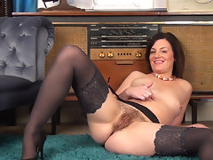 Sofia Matthews is wearing black stockings and no panties under her pretty dress. She undoes her see through bra and plays with her petite tits. She pulls on her hairy pussy which turns her on. video