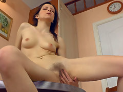 Ginger Alice is cleaning up in the kitchen when she starts to get horny, rubbing her hairy pussy through her panties. Then she gets undressed so she can run her fingers through her hairy mound.video