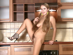 In her sweet pigtails, hairy girl Chloe B is ready for some kitchen fun. She strips off her yellow mini skirt and panties, then shows off her round ass and sits to show off her hairy pussy.video