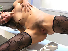 As she slowly takes off her sexy black lingerie, Carmen sits down on the top of the stairs and rubs her meaty moist hairy lips.video