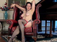 Erotic Brianna Green sits on a leather chair by a piano, and slowly strips to show her sexy body. It delights her to strip, play with her hairy pussy, and fondle her all-natural breasts in pleasure.video