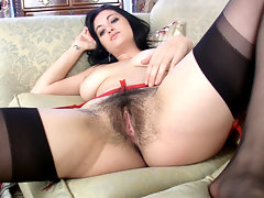 While looking at some erotic photos of fellow hairy girls, Brook Scott can\'t help but strip off her clothes and give her own moist hairy pussy some attention.video
