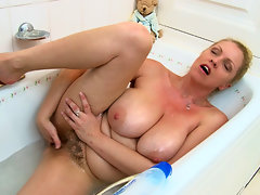 Teya is so in need of a bath that she doesn\'t even bother to take off her white panties and tank top before hoping in and letting her hairy body soak. Watch what else she does in this hairy porn!video