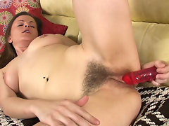 Sexy Ariel Heart rubs her wet pink pussy through her panties before laying back on the couch and driving her dildo into her box.video