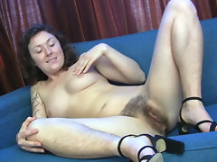 Luca is a sexy brunette who can't stop touching her sexy legs. Slowing stripping out her black bra and panties she reveals an awesome set of natural tits and a hairy pussy before rubbing her snatch.video