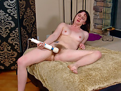 Hairy woman Thelma Sleaze is a sexy brunette beauty laying in front of a fireplace when she gets hot and horny and grabs her big vibrator and uses it to tease her hairy pussy until she has an orgasm.video