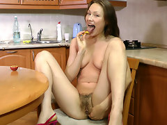 Nata has nothing to do as she goes to the kitchen and decides to snack on some coffee and fruit. The fruit tastes really good, but it tastes even better when she rubs it on her hairy pussy!video