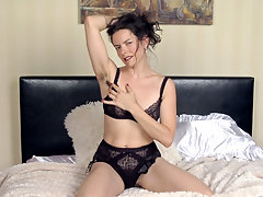 A fine and sexy Lucia is in her finest wear. She tells a sexy take, and in her black lingerie and stockings looks breathtaking. As she strips and is naked, she strokes her hairy pussy and looks wet.video