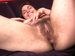 Monica quickly tickles her clit and fingers her meaty bush on the sofa. The thought of hairy girls got her too hot!video