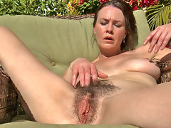Hairy woman Veronica Snow decides to spend the day in the sun taking care of her garden but when she gets hot she decides to strip out of her clothes and get some sun on her hairy pussy instead.video