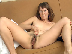 Charlotte B is lounging around in nothing but a Tshirt and a pair of cowboy boots. It\'s no wonder she winds up touching her hairy body all over, giving her hairy pussy some extra special attention.video