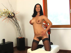 Dressed all in black withe her dress and sheer black stocking and shoes Winnie looks really hot. When she takes off her dress she has on a black bra and thong! And then she plays with her hairy pussy!video