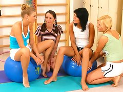 Four hot lesbian schoolgirls kissing and getting naked at the gymvideo