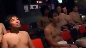 An Asian girl in a nurses uniform is doing a striptease in a theatre, watched by a group of men in their underpants. Then one guy comes up to fuck her, followed by the rest who all come over her face, covering her in sperm.video
