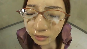 Senna Kurosaki gives blowjobs & a handjob  has sex with her co-workers then receives bukkake facials in return.video