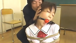 Momo Nakamura  Chihiro Hasegawa and Marin Izumi are schoolgirls in this bondage themed movie. They\'re in school uniforms and they get tied up  made to suck cocks and fucked in different positions.video