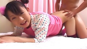 What a cute Asian teen this babe Ami Kago is as she has a sweet face and a beautiful slim body with nice small tits and a juicy round ass that you will see her bouncing all over the place as she gets absolutely pounded in her tight pussy from behind!video